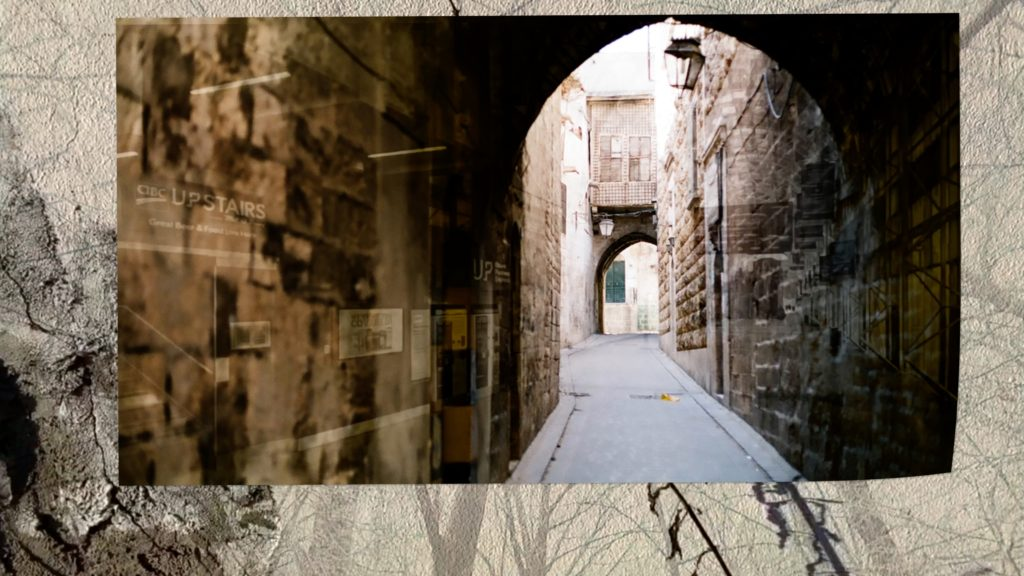 image of an archway in Aleppo, Serbia superimposed on the wall background of the poetry film
