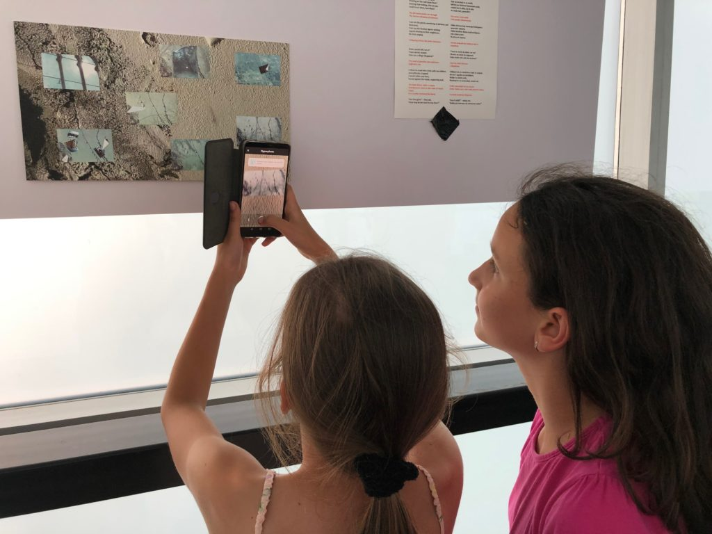 two young girls interacting with the AR installation